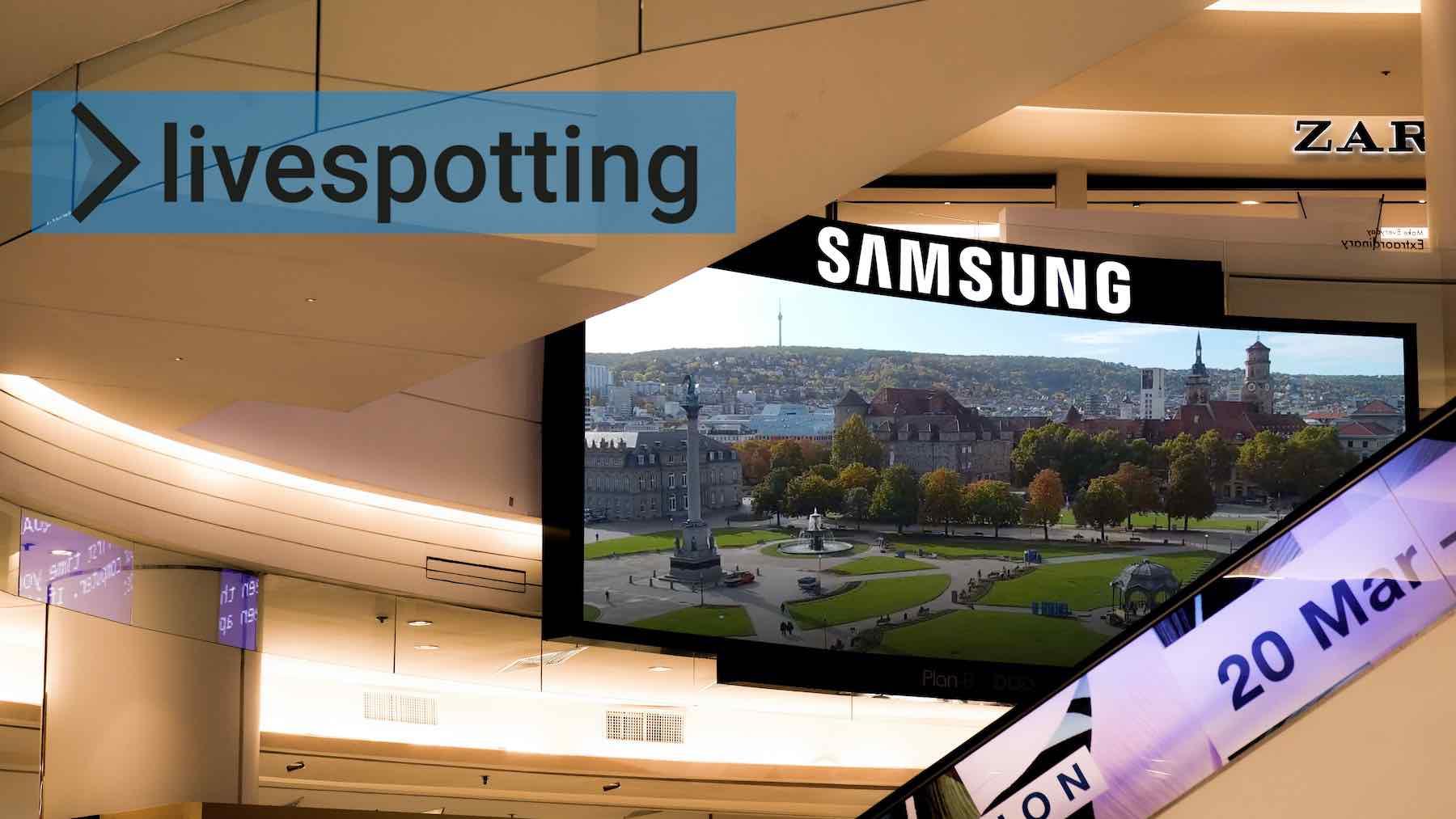 Livestream auf einem großen Fernsehgerät in einem Einkaufszentrum.